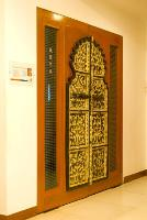 an old Rajasthani door panel fused within a modern wooden door frame.