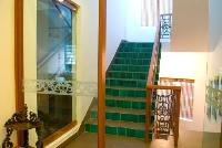 stair leading to the terrace has an emerald green handmade tile riser.