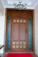 the main door with inlaid tiles.