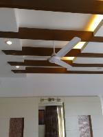 detail of the false ceiling with recessed cove lights.