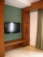 the flat screen television opposite the bed.