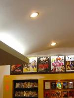 movie posters displayed above DVD racks