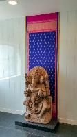 A Statue of Ganesa placed against a backdrop made from a saree. This is just outside the door to the MD's cabin.